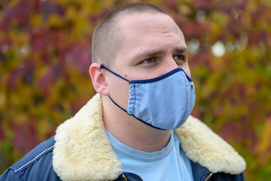 Casual young man wearing a cloth face mask