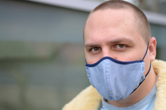Serious young man wearing a face mask