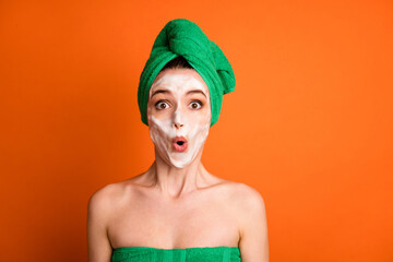 Photo of amazed funny lady wear green towel head made lips pouted isolated orange color background