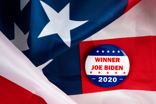 winner joe biden text on american election vote button on united states national flag. 2020 presidential election concept.