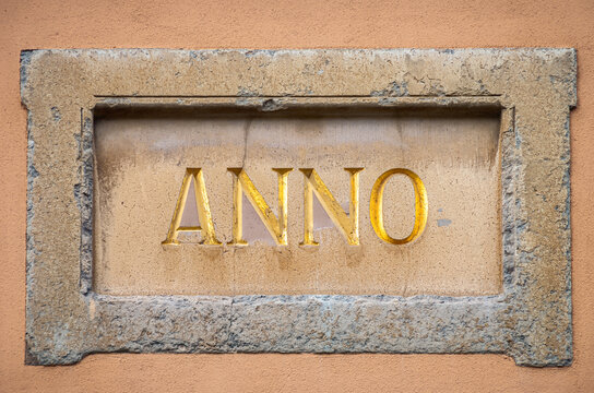 "Kartusche ANNO - Decorative frame or cartouche with the Latin inscription ANNO for ""In the year"" on a house facade."