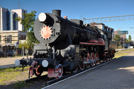 Vintage locomotive close-up. Train, transport, rails