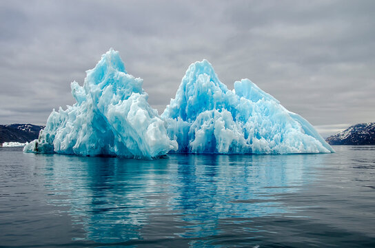 Bluish iceberg melting and forming curious shapes