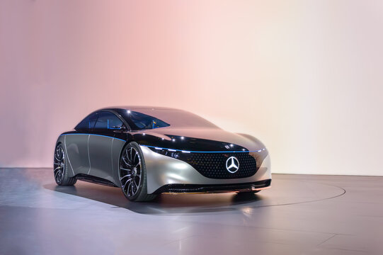 FRANKFURT - SEP 15, 2019: Silver Mercedes-Benz Vision EQS - Premiere of fully electric luxury concept car with futuristic design at IAA 2019 International Motor Show against pink background