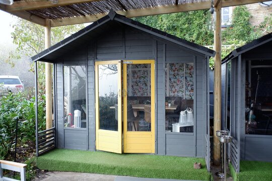 Wooden cabin for family dining outside pub during the Coronavirus (Covid-19) pandemic