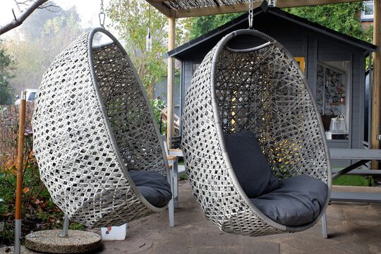 Two hanging egg chairs outside pub during the Coronavirus (Covid-19) pandemic