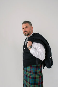 handsome mature courageous stylish man scotsman in kilt and suit. Style, fashion, lifestyle, culture, ethnic concept.