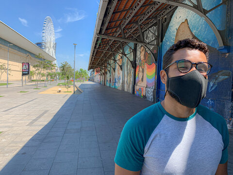 Young bearded latino face masked adult in Rio de Janeiro port