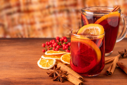 German tradition winter Christmas market new year holidays festival drink Gluhwein Mulled sweet hot warm red Wine with spices citrus aromatic cinnamon star anise