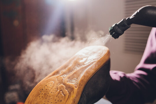 washing the dirty cleaning the shoes with a steam cleaner.