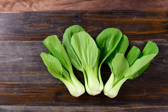 Fresh Bok Choy or Pak Choi(Chinese cabbage) on wooden background, Organic vegetables, Top view