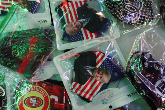 Face masks with the image of Democratic U.S. presidential nominee Joe Biden are displayed for sale at Times Square in New York City