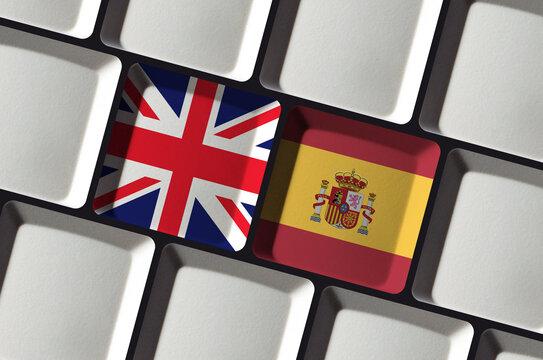 Keyboard with British United Kingdom and Spanish Spain flag - concept language learning, translation or bilateral partnership