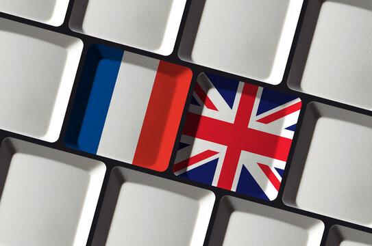 Keyboard with French France and British United Kingdom flag - concept language learning, translation or bilateral partnership
