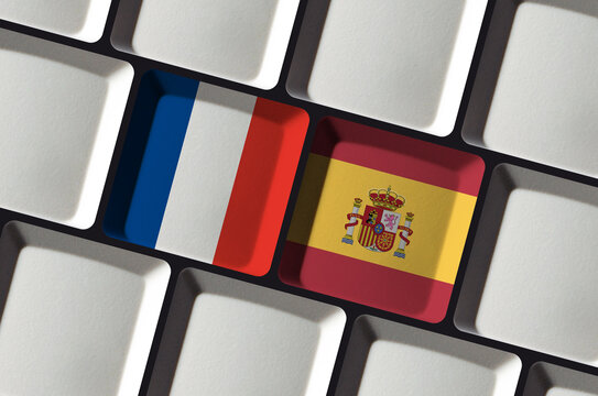 Keyboard with French France and Spanish Spain flag - concept language learning, translation or bilateral partnership
