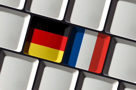 Keyboard with German and French flag - concept language learning, translation or bilateral partnership