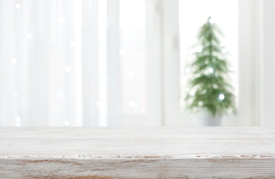 Empty vintage wood table in front of blurred holiday background