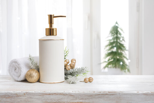 Spa concept with soap dispenser, white towel and Christmas ornaments