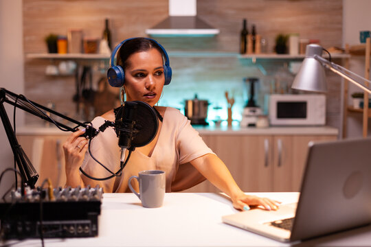 Famous blogger streaming from home studio using professional recording gear. On-air online production internet broadcast show host streaming live content, recording digital social media communication