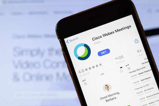 Los Angeles, California, USA - 24 March 2020: Cisco Webex Meetings app logo on phone screen close up with website on background with icon, Illustrative Editorial