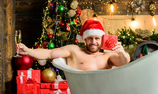 Confident and sexy. xmas present. christmas spa. happy new year gift. erotic wish. feel desire. macho drink champagne after party. sexy mature man bath. winter holidays. muscular man relax bathtub