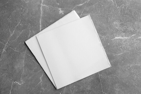Clean napkins on marble table, top view