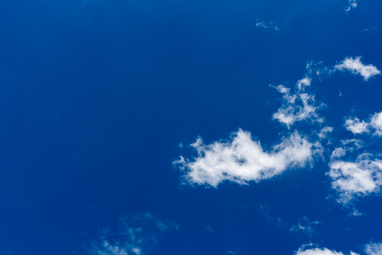 african stock photo of white clouds in a crisp blue sky