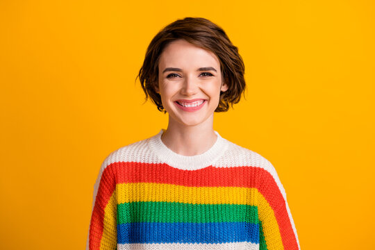 Photo of charming young girl toothy smile look camera wear striped sweater isolated vibrant yellow color background