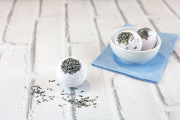 Handmade lavender bath bombs on white brick background