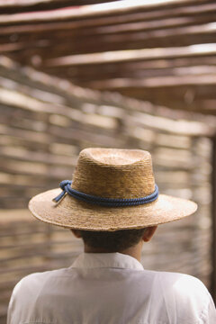 Rear view portrait of man wearing straw hat