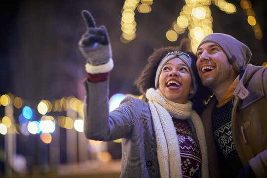 Mixed couple having a walk; Christmas feeling concept