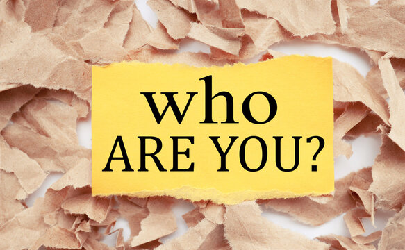 who are you, text on yellow paper on torn paper background