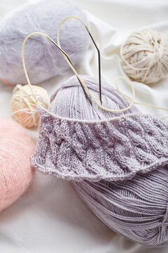 Balls of wool and mohair for knitting in pastel colors