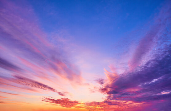 sunset sky with multicolor clouds. sky for replacement in architectural photography or 3d design.