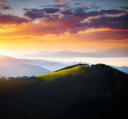 Wall Mural - Spectacular sunrise in morning mountain landscape.