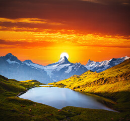 Wall Mural - Majestic sunset over the Grindelwald Valley in the Swiss Alps. Location place of Bachalpsee lake, Switzerland.