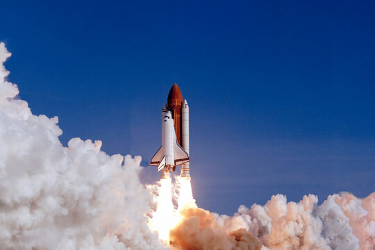 The launch of the space shuttle against the background of the sky and smoke. Elements of this image furnished by NASA