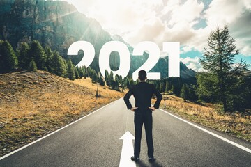 The 2021 New Year journey and future vision concept . Businessman traveling on highway road leading...