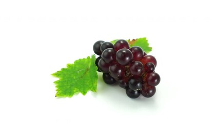 Fototapete - Bunch of fresh grape with leaf on white background Zoom in.