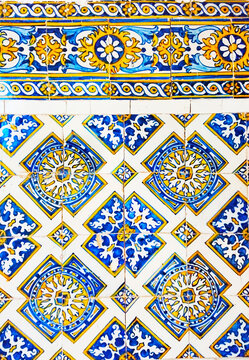 Detail of the traditional tiles from facade of old house. Decorative tiles.Portuguese traditional tiles. Floral ornament.