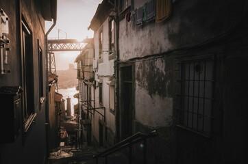 The view on dominant Portos bridge Ponte de Dom Luís I, from amazing narrow alley in Porto city. Autumn 2019.