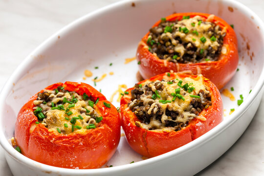 baked tomatoes filled with lentils