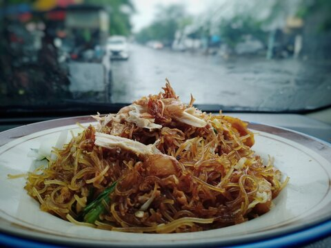 Indonesian food. Fried vermicelli, served with shredded chicken breast, vegetables, and fried shallots. This is a popular traditional street food in Java.