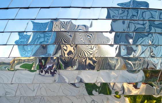 optical reflection on the metal facade of a modern building forming abstract patterns,free copy space