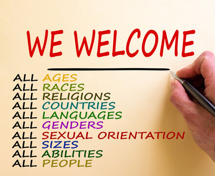 Hand writing 'we welcome', isolated on white background. Business concept.  Diversity ethnicity gender age sexual orientation religion disability words. Copy space. Equality and diversity concept.