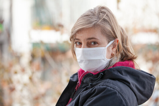 portrait of woman in medical mask outdoors