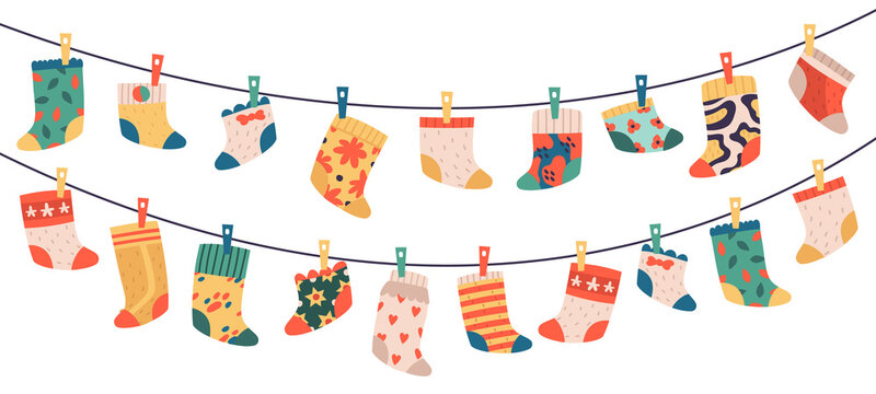 Children socks. Hanging colorful drying cotton or wool socks, cute baby clothes, socks hang on laundry rope vector illustration symbols set