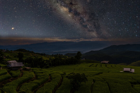 Milky way rising over step rice fields in Chiang Mai, Thailand.