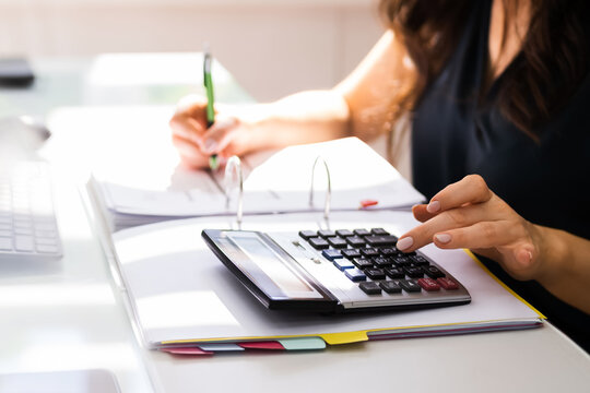 Chartered Accountant Hand Calculating Tax