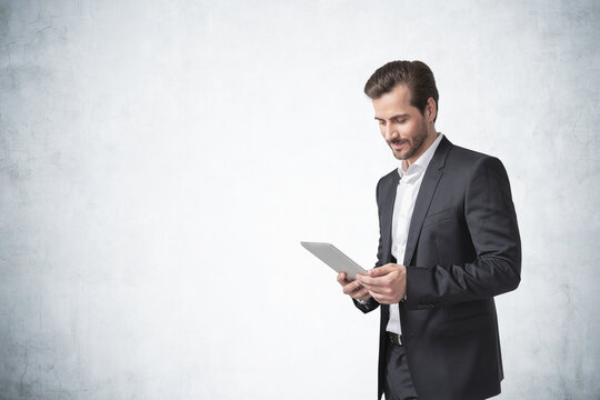 Bearded young businessman with tablet, mock up